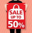 Man holding a sale paper vector