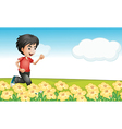 A boy running in the garden vector