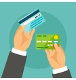 Hands holding bank cards in flat design style vector