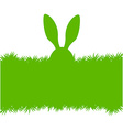 Easter bunny ears on grass greeting card vector