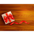 Holiday background with gift box and red ribbons vector