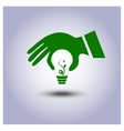 Green ecology light bulb icon in hand vector