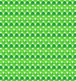 Seamless pattern of green abstract crosses vector