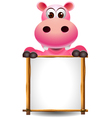 Funny hippopotamus cartoon with blank sign vector