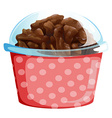 A cupcake inside the pink polkadot container vector