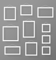 Blank picture frames set on the wall vector