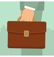 Businessmans hand holding briefcase vector