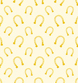 Gold seamless pattern of lucky horse shoes vector