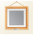 Blank wooden photo frame on the wall vector