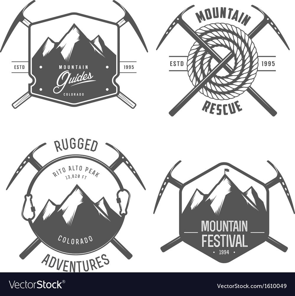 Set of vintage mountain explorer labels and badges vector image