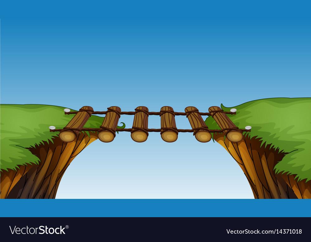 Wooden bridge between cliffs vector image