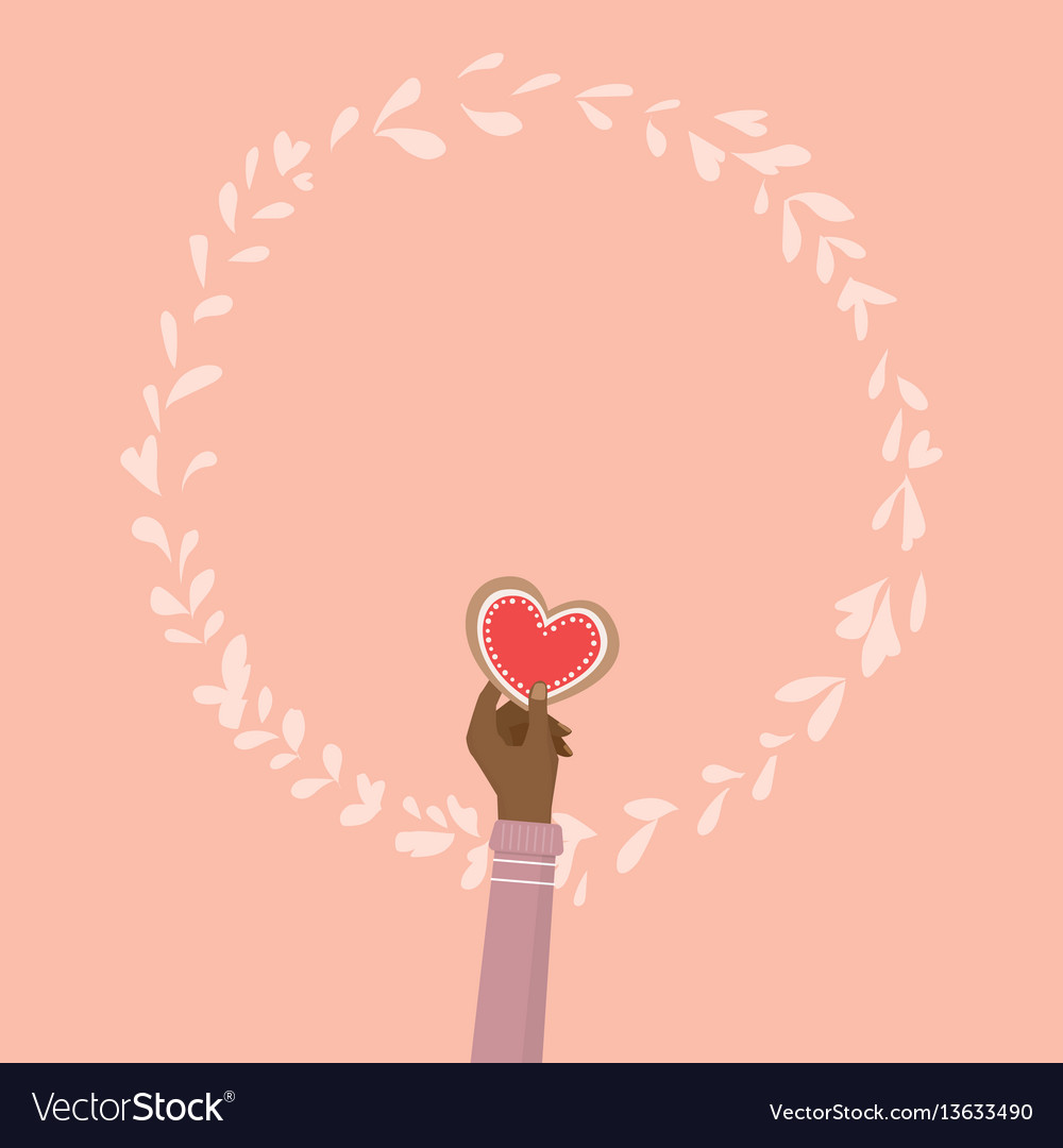 Hand holding heart cookie for valentines day vector image