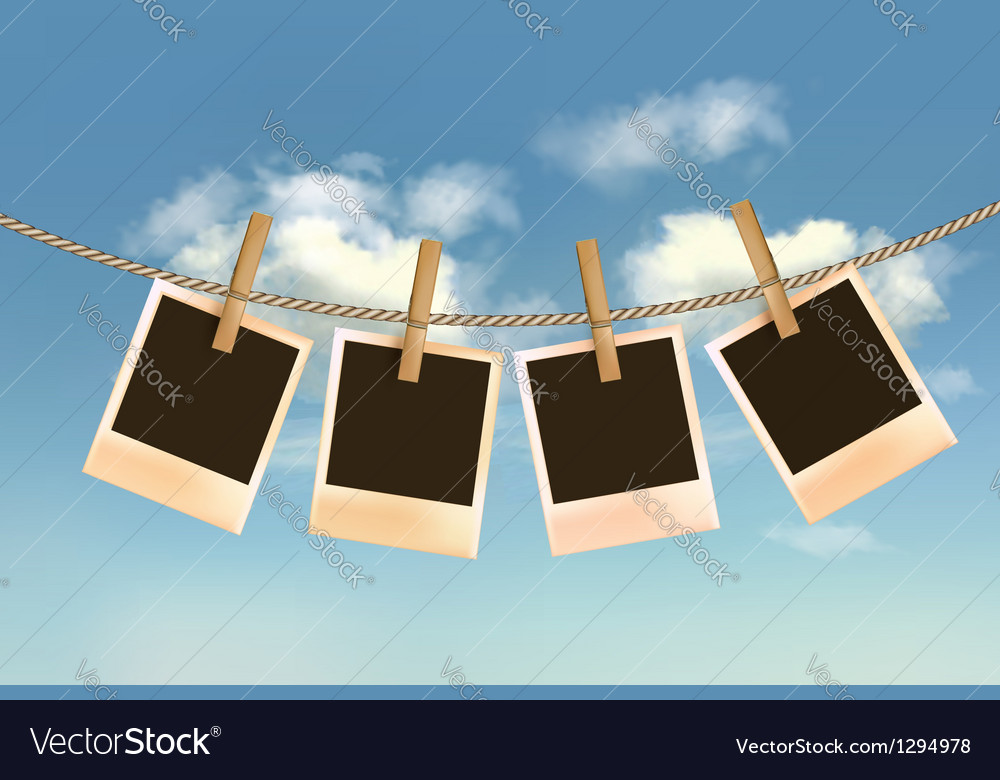 Retro photos hanging on a rope in front of a blue vector image