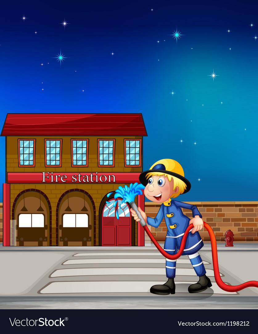A fireman near a fire station vector image