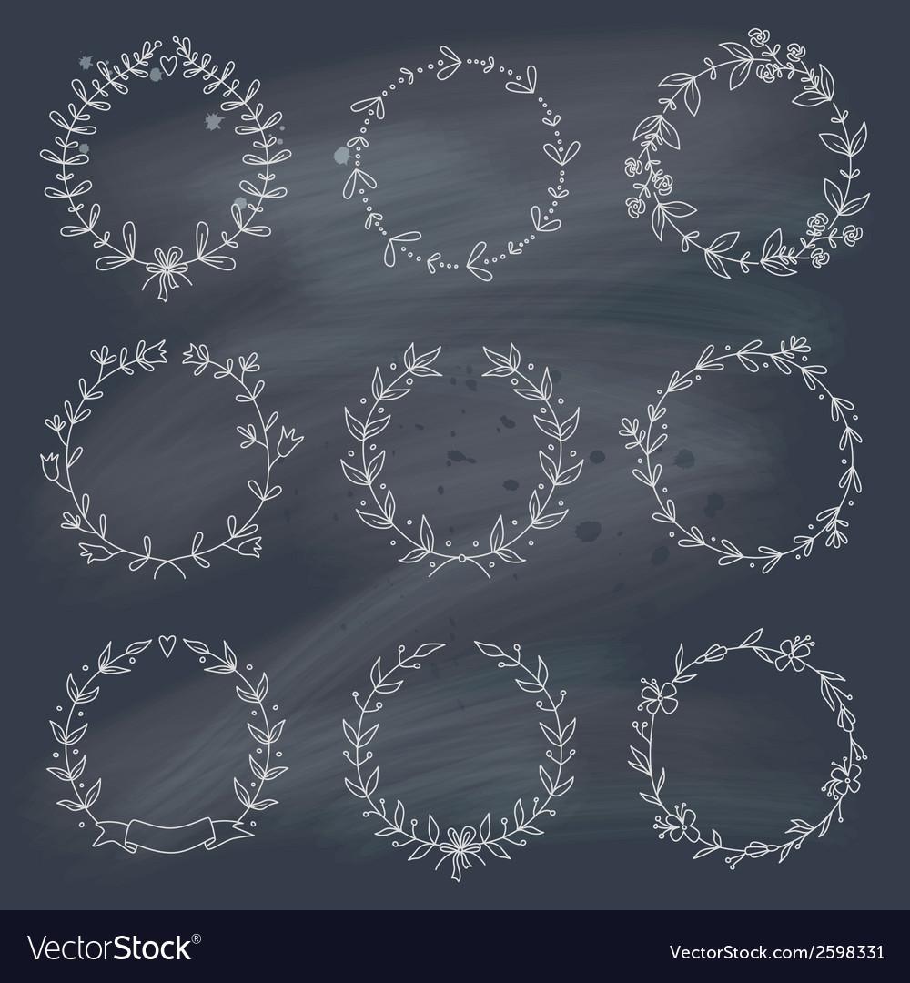 Set of 9 hand drawn wreaths on blackboard vector image