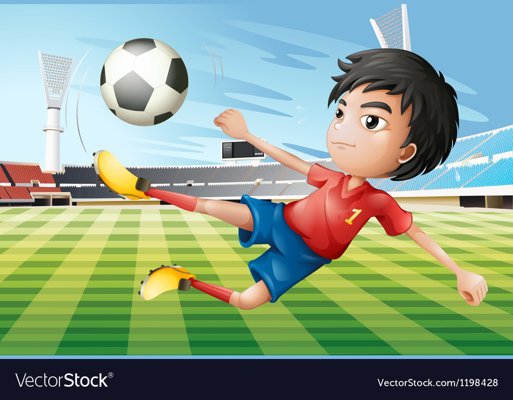 A boy playing soccer at the soccer field vector image