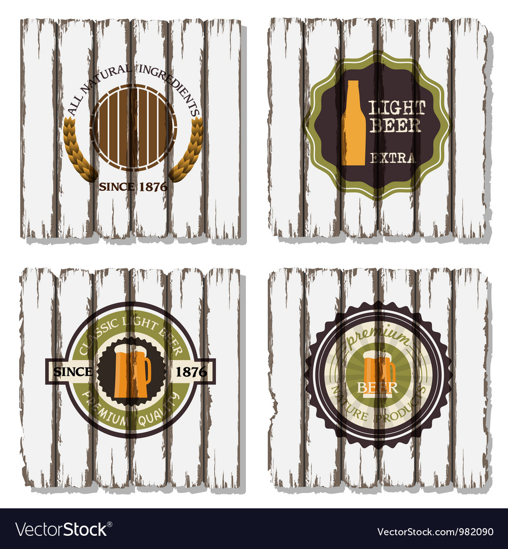 Four beer labels on old wood background vector