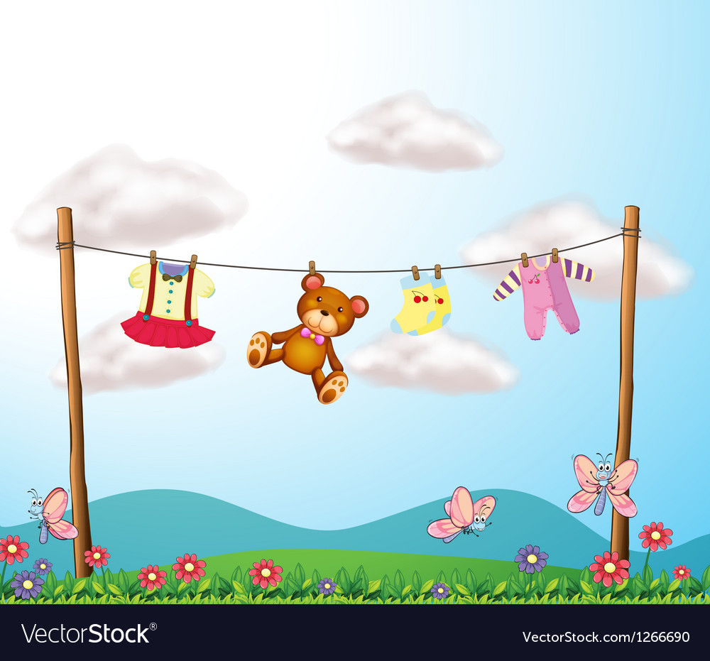 A childs clothes hanging with a teddy bear vector