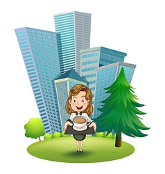 A woman outside the building holding a tray with vector