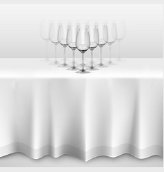 Table with a tablecloth glasses vector