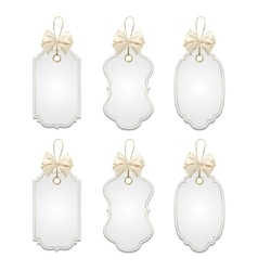 Set of elegant tags with silver and golden bows vector