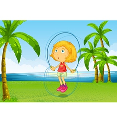 A girl playing skipping rope at the riverside vector