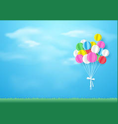 Colorful balloons flying over grass paper art and vector