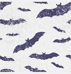Seamless halloween pattern with bats grunge vector