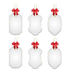 Set of elegant tags with red bows vector
