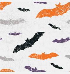 Seamless halloween pattern with bats grunge vector