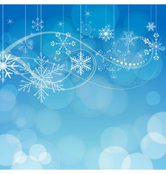 abstract snowflakes on blue bokeh background vector image