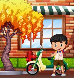 Little boy and motocycle on street vector