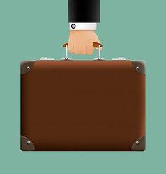 man in a suit holding a brown briefcase vector image