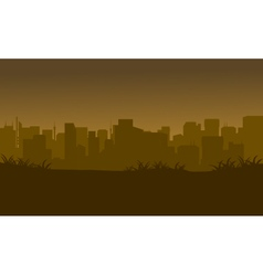 Silhouette of city in the fields vector