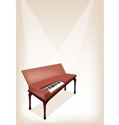 A retro clavichord on brown stage background vector