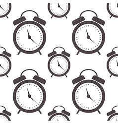 Seamless pattern with closeup black alarm clocks vector