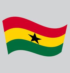 Flag of ghana waving on gray background vector
