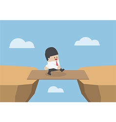 Businessman cross the cliff gap by wooden board as vector image