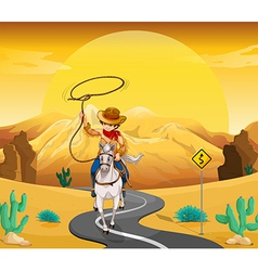 A cowboy riding on a horse travelling through the vector image