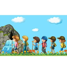 Children hiking in the field vector image vector image
