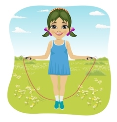 Little girl jumping with skipping rope in park vector