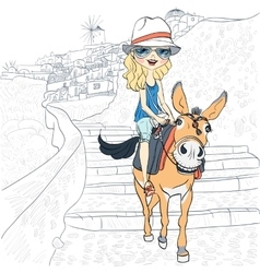Beautiful girl on a donkey in oia santorini vector