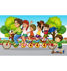 Family riding bike in the park vector image vector image