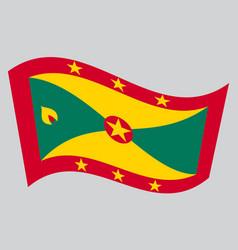 Flag of grenada waving on gray background vector