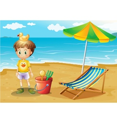 A young boy and his toys at the beach vector