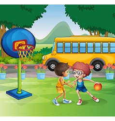 Two boys playing basketball near the school bus vector