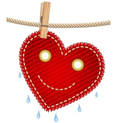Textile red heart on a clothesline vector