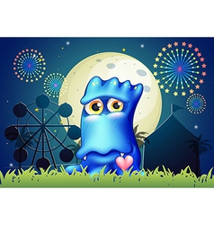 A blue monster near the grass at the carnival vector