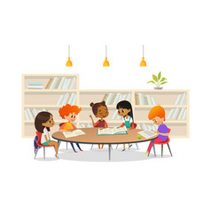 group of children sitting around table at school vector image