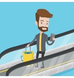 Man using smartphone on escalator in airport vector